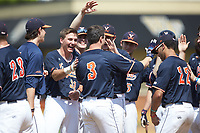 Jack Weiller (3) of the Virginia Cavaliers is greeted by his teammates after hitting a home run against the Wake Forest Demon Deacons at David F. Couch Ballpark on May 19, 2018 in  Winston-Salem, North Carolina.  The Demon Deacons defeated the Cavaliers 18-12.  (Brian Westerholt/Four Seam Images)