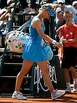 June 3, 2010. Elena Dementieva of Russia leaving the court after retiring from her semi-final match against Francesca Schiavone of Italy, in the semi-final of the French Open, played at Stade Roland Garros, Paris France
