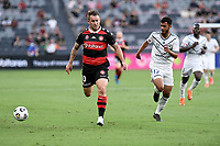 10th February 2021; Bankwest Stadium, Parramatta, New South Wales, Australia; A League Football, Western Sydney Wanderers versus Melbourne Victory; Simon Cox of Western Sydney Wanderers chases the ball as Biirkan Kirdar of Melbourne Victory covers