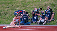 5th June 2021; Birmingham University Athletics Track, Birmingham, Midlands, England; European 10000 Metre Finals, British Olympic Trials 10000 Metre; Eilish McColgan exhausted after the race lays on the track in front of Press