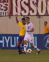 USA forward Alejandro Bedoya (11) passes back as Brazil defender Andre Santos (6) defends. Brazil  defeated the US men's national team, 2-0, in a friendly at Meadowlands Stadium on August 10, 2010.