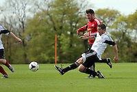 Pictured: Michael Eames tackled by Chirs Barney. Tuesday 06 May 2014<br /> Re: Members of the local press play football against Swansea City FC coaches and members of staff at the Club's training ground in Fairwood, south Wales.