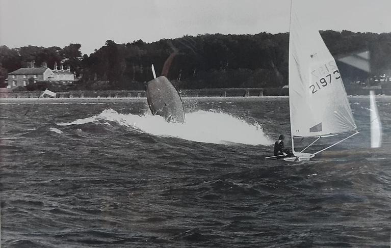 Trevor Millar's Laser bottom' up in Ballyholme Bay