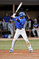 Left fielder Bakari Gayle (1) of the Spartanburg Methodist College Pioneers hits in a junior college game against Surry Community College on January 31, 2016, at Mooneyham Field in Spartanburg, South Carolina. (Tom Priddy/Four Seam Images)