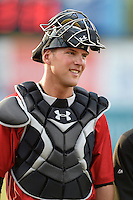 Birmingham Barons catcher Kevan Smith (32) walks to the dugout from the bullpen before a game against the Chattanooga Lookouts on April 24, 2014 at AT&T Field in Chattanooga, Tennessee.  Chattanooga defeated Birmingham 5-4.  (Mike Janes/Four Seam Images)