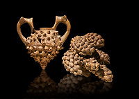 Hittite terra cotta two handled vessel and a ritual vessel in the shape of a bunch of grapes - 16th century BC - Hattusa ( Bogazkoy ) - Museum of Anatolian Civilisations, Ankara, Turkey . Against black background