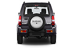 Straight rear view of a 2014 Suzuki JIMNY JLX X-Citement 3 Door SUV 4WD Rear View  stock images