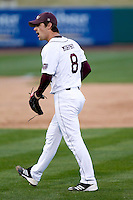 Clay Murphy (8) of the Missouri State Bears walks off the mound after striking out a batter during a game against the Oklahoma State Cowboys at Hammons Field on March 6, 2012 in Springfield, Missouri. (David Welker / Four Seam Images)