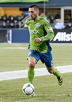 November, 2013: CenturyLink Field, Seattle, Washington: Seattle Sounders FC forward Clint Dempsey (2) dribbles the ball  as the Portland Timbers defeat  the Seattle Sounders FC 2-1 in the Major League Soccer Playoffs semifinals Round.