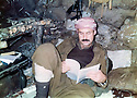 Iraq1988 <br /> Nechirvan Ahmed reading in a shelter in Gali Sate <br /> Irak 1988 <br /> Nechirvan Ahmed a Gali Sate lisant dans un abri