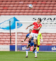 2nd April 2021, Oakwell Stadium, Barnsley, Yorkshire, England; English Football League Championship Football, Barnsley FC versus Reading; Domi nik Frieser of Barnsley wins a header and flicks on past Liam Moore of Reading