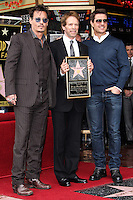 HOLLYWOOD, CA - JUNE 24: Johnny Depp, Jerry Bruckheimer and Tom Cruise attends the ceremony honoring Jerry Bruckheimer with a Star on The Hollywood Walk of Fame held in front of El Capitan Theatre on June 24, 2013 in Hollywood, California. (Photo by Celebrity Monitor)