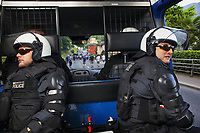 Switzerland. Canton Ticino. Lugano. Two police officers from TPO (Transport Police). The policemen wear the special riot police black uniforms and helmets. They seat inside the TPO van following the FC Luzern football club's supporters walking towards the Cornaredo stadium. The ultras fans can become violent at any time. TPO (Transport Police) is the Swiss Federal Railways Police. Swiss Federal Railways (German: Schweizerische Bundesbahnen (SBB), French: Chemins de fer fédéraux suisses (CFF), Italian: Ferrovie federali svizzere (FFS)) is the national railway company of Switzerland. It is usually referred to by the initials of its German, French and Italian names, as SBB CFF FFS. 2.06.2017 © 2017 Didier Ruef