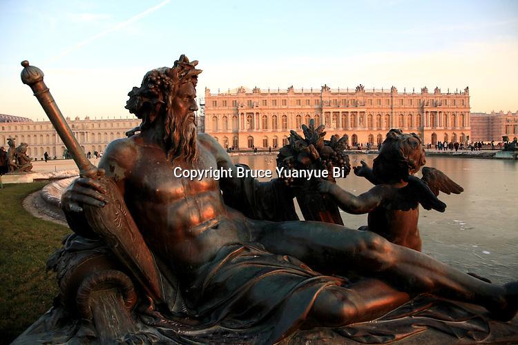 Bronze fountain statues in the garden of Chateau de Versailles Palace. Versailles. Paris
