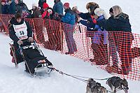 Aaron Burmeister team leaves the start line during the restart day of Iditarod 2009 in Willow, Alaska
