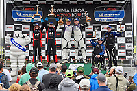 #23 Fast MD Racing Audi RS3 LMS TCR DSG, TCR: Nick Galante, James Vance, Nick Galante, #21 Byan Herta Autosport W Curb-Agajanian Hyundai Veloster N TCR, TCR: Mason Filippi, Harry Gottsacker, #54 JDC-Miller MotorSports Audi RS3 LMS TCR DSG, TCR: Michael Johnson, Stephen Simpson, Michelin Man celebrate the win on the podium