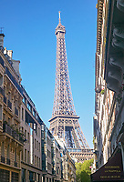 The Eiffel Tower looms over the Rue de Monttessuy, Paris, France