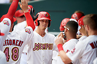Memphis Redbirds starting pitcher Luke Weaver (8) high fives with his teammates in the dugout during a game against the Iowa Cubs on May 29, 2017 at AutoZone Park in Memphis, Tennessee.  Memphis defeated Iowa 6-5.  (Mike Janes/Four Seam Images)