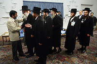 Iranian President Mahmoud Ahmadinejad shakes the hands of, and greets six rabbis from an anti-Zionist movement during a controversial Holocaust Conference in 2006.