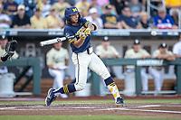 Michigan Wolverines outfielder Jordan Brewer (22) swings the bat against the Vanderbilt Commodores during Game 3 of the NCAA College World Series Finals on June 26, 2019 at TD Ameritrade Park in Omaha, Nebraska. Vanderbilt defeated Michigan 8-2 to win the National Championship. (Andrew Woolley/Four Seam Images)