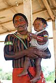 Pará State, Brazil. Aldeia Pukararankre (Kayapo). Ireroko Kayapo with his son.