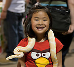 5 year Madilynn holds an albino ball python at the Reno Repticon event held on Sunday afternoon, February 10, 2013 at the Reno Livestock Events Center in Reno, Nevada.