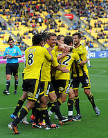 Andrew Durante is mobbed by his Phoenix teammates after his goal during the A-League football match between Wellington Phoenix v Gold Coast United at Westpac Stadium, Wellington, New Zealand on Sunday, 4 March 2012. Photo: Dave Lintott / lintottphoto.co.nz