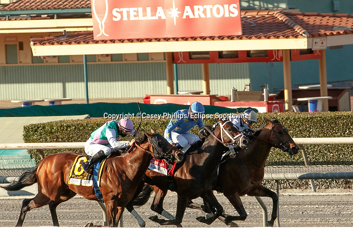 ARCADIA, CA  MARCH 6: #2 Hit the Road, ridden by Florent Geroux, (rail), holds off #1 Smooth Like Strait, ridden by Umberto Rispoli, and #6 Flavius, ridden by Flavien Prat, in the stretch of the Frank E. Kilroe Mile (Grade l) on March 6, 2021 at Santa Anita Park in Arcadia, CA. (Photo by Casey Pnillips/ Eclipse Sportswire/ CSM)