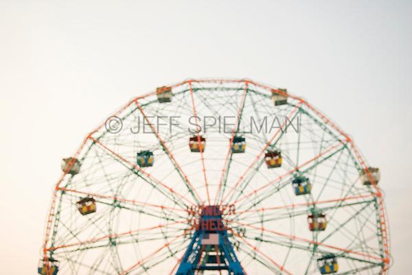 Soft Focus (defocused) view of the Wonder Wheel (landmark ferris wheel) at Coney Island, Brooklyn, New York City, New York State, USA