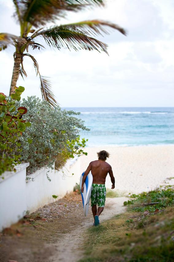 Local windsurfer, surfer, SUPer, Brian Talma, at Silver Rock Beach, location of his watersports shop, De Action.Silver Rock, Christ Church Parish.Barbados