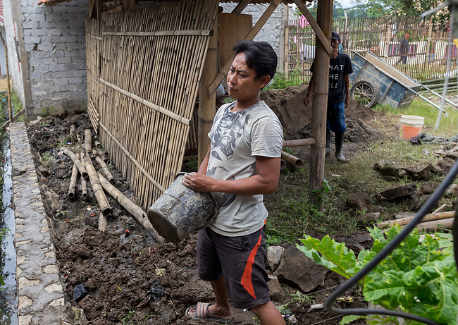 29 JAN, 2018, Bandung, Indonesia: Construction worker Yusup Bu Rhanudin from Pangkalan village,<br /> Cihaur sub district, West Bandung commenting on the stench from the polluted river that regularly invades his house. The Citarum river in West Java, Indonesia is listed as one of the most polluted rivers in the world.  It will soon be the main water supply system for Jakarta as the bores that have been dug into the aquifers dry but it also supports agriculture, fishery, industry, sewerage and electricity.      Picture by Graham Crouch/The Australian