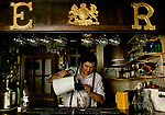 The Village Pub. The Falcon, Arncliffe Yorkshire. <br /> David Miller the landlord ( 4th generation owners of the is pub) is pouring a pint from a jug, there are no hand pumps. He is taking the top of the pint off with a wooden spurtle 1990s 1991