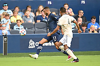 KANSAS CITY, KS - JUNE 26: Khiry Shelton #11 Sporting KC with the ball during a game between Los Angeles FC and Sporting Kansas City at Children's Mercy Park on June 26, 2021 in Kansas City, Kansas.