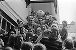 Royal Shrovetide Football. Ashbourne Derbyshire, England 1974. Takes place annually on Shrove Tuesday and Ash Wednesday. Mr Don Lowndes holding ball aloft, after lunch on the steps of the Green Man & Black's Head Royal Hotel.