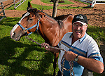 """Ken Danyluk grazes his purebred arabian horse, Status Symbol, on May 12, 2012 at Pimlico Race Course in Baltimore, Maryland. There will be a Grade 1 race for Arabians on the Preakness Card. Danyluk is the owner, trainer and groom. """"This is the first time, I think, any Arabian has ever grazed and eater grass here at Pimlico,"""" he said."""