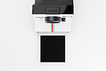 Vintage instant camera with empty frame, evenly lit on a clean studio background. Accurate CGI model based on popular Polaroid Land Camera One Step first introduced in 1977.