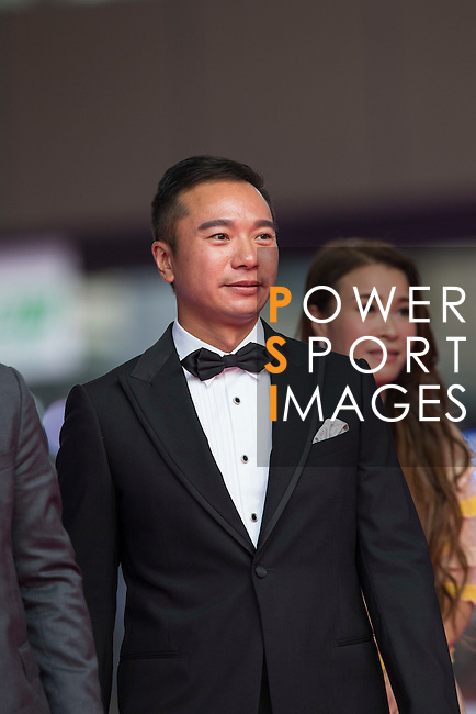 Tenniel Chu and his wife Carmen walk the Red Carpet event at the World Celebrity Pro-Am 2016 Mission Hills China Golf Tournament on 20 October 2016, in Haikou, China. Photo by Victor Fraile / Power Sport Images