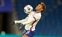 LE HAVRE, FRANCE - APRIL 13: Crystal Dunn #19 of the United States traps the ball during a game between France and USWNT at Stade Oceane on April 13, 2021 in Le Havre, France.