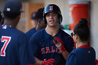 Nick Yorke (3) of the Salem Red Sox is greeted by teammates after scoring a run during the game against the Kannapolis Cannon Ballers at Atrium Health Ballpark on July 30, 2021 in Kannapolis, North Carolina. (Brian Westerholt/Four Seam Images)
