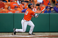Virginia Cavaliers first baseman Jared King #13 swings at a pitch during a game against the Clemson Tigers at Doug Kingsmore Stadium on March 15, 2013 in Clemson, South Carolina. The Cavaliers won 6-5.(Tony Farlow/Four Seam Images).