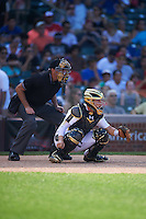 Umpire Mike Droll and catcher Michael Amditis (2) of Boca Raton Community High School in Boca Raton, Florida during the Under Armour All-American Game on August 15, 2015 at Wrigley Field in Chicago, Illinois. (Mike Janes/Four Seam Images)