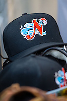 A Norfolk Tides cap sits in the visitors dugout during the game against the Charlotte Knights at BB&T Ballpark on May 21, 2014 in Charlotte, North Carolina.  The Tides defeated the Knights 10-3.  (Brian Westerholt/Four Seam Images)