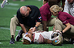Florida State trainers check on quarterback Deondre Francois after an injury in the second half of the Chick-fil-A Kickoff game at the new Mercedes-Benz Stadium in Atlanta, Georgia on September 2, 2017. Alabama defeated Florida State 24-7.  Photo by Mark Wallheiser/UPI