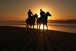 Palestinian men ride their horse as they enjoy the last sunset of 2016 at the beach of Gaza city, on the December 31, 2016. Photo by Ashraf Amra