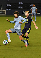 KANSAS CITY, KS - OCTOBER 11: #6 Ilie Sanchez of Sporting Kansas City gets to the ball ahead of #6 Dax McCarty of Nashville SC during a game between Nashville SC and Sporting Kansas City at Children's Mercy Park on October 11, 2020 in Kansas City, Kansas.