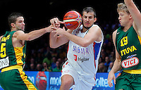 Serbia's Nemanja Bjelica (C) vies with Lithuania's Mantas Kalnietis (L) and Mindaugas Kuzminskas (R) during European championship semi-final basketball match between Serbia and Lithuania on September 18, 2015 in Lille, France  (credit image & photo: Pedja Milosavljevic / STARSPORT)