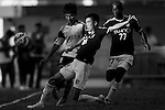 (L-R) Jingde Chen of Wofoo Tai Po competes for the ball with  Festus Baise of Sun Pegasus FC and  Kwok Keung Sham of Sun Pegasus FC during the HKFA Premier League between Wofoo Tai Po vs Sun Pegasus at the Tai Po Sports Ground on 22 November 2014 in Hong Kong, China. Photo by Aitor Alcalde / Power Sport Images