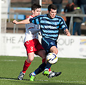 Forfar's Dale Hilson gets away from Stranraer's Jackson Longridge.