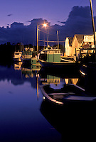 lobster fishing boats, Prince Edward Island, Canada, P.E.I., Gulf of St. Lawrence, Fishing boats docked at night in the harbor of the fishing village of New London on Prince Edward Island.