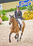 19 April 2009: Ben Maher  (GBR) and Robin Hood W at the Rolex World Cup Jumping Final round.